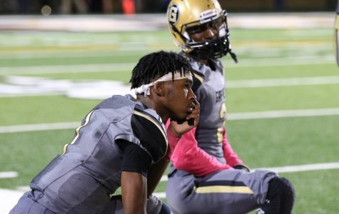 Tyshun Sarratt looks on from the sideline on Friday night.