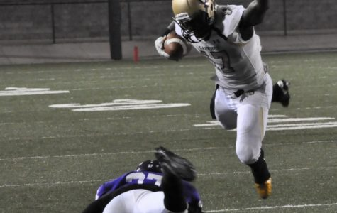 Cameron Rice leaps a Northwestern defender