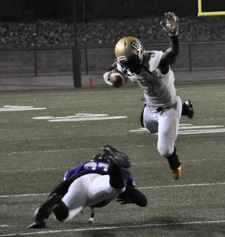 Cameron Rice leaps a Northwestern defender