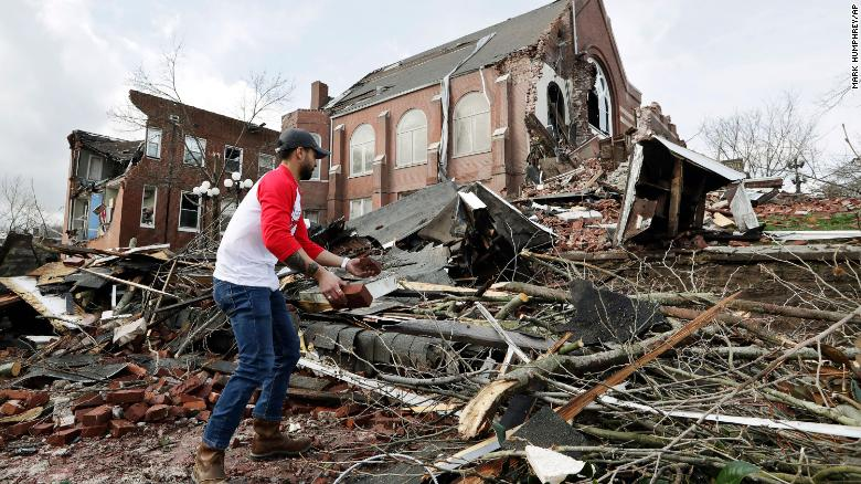 Sumant+Joshi+helps+to+clean+up+rubble+at+a+Nashville+church+Tuesday.