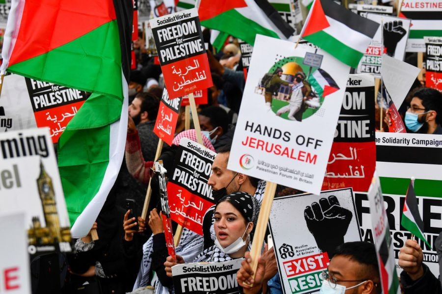 Pro-Palestinian demonstrators attend a protest following a flare-up of Israeli-Palestinian violence, in London, Britain May 11, 2021. REUTERS/Toby Melville